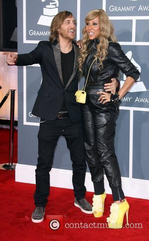 David Guetta and wife Cathy Guetta 54th Annual GRAMMY Awards - 2012 Arrivals held at the Staples Center Los Angeles,...