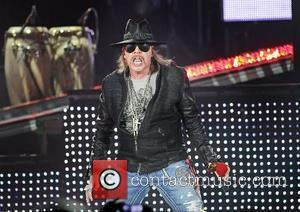Axl Rose Takes A Tumble Onstage In England