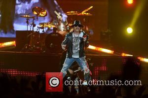Axl Rose Suffers Stage Fall