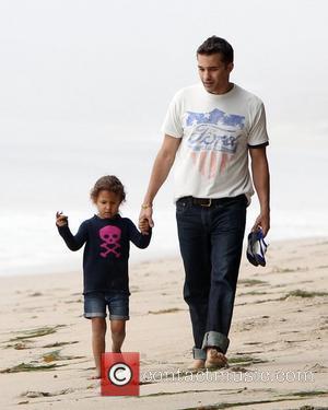 Olivier Martinez and Nahla Aubry walk along Malibu Beach Malibu, California - 21.04.12