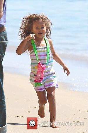 Nahla Aubry playing on Malibu Beach Los Angeles, California - 07.03.12