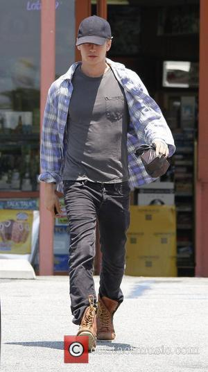 Hayden Christensen wearing a baseball cap and checked shirt, shops at a local liquor store for cigarettes Los Angeles, California...