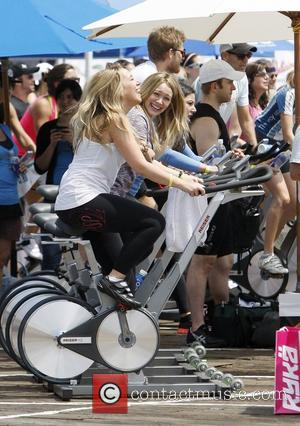 Haylie Duff and Hilary Duff new mom Hilary Duff attends a charity cycling event with her sister in Santa Monica...