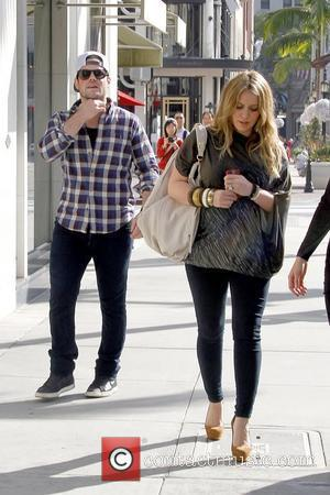 Mike Comrie and Hilary Duff Hilary Duff shows off her growing baby bump while out shopping in Beverly Hills with...