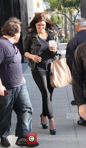 Gina Carano  visits a Starbucks cafe Beverly Hills, California - 02.02.12