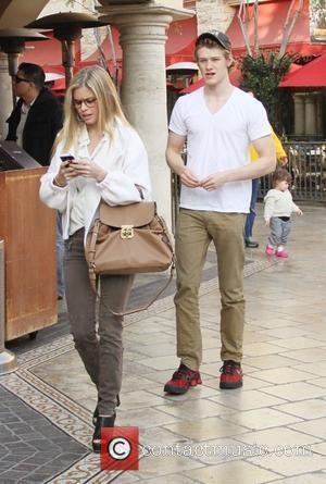Lucas Till and his girlfriend walk through The Grove West Hollywood, California - 19.01.12