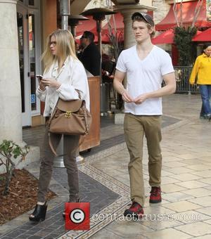 Lucas Till and his girlfriend walk through The Grove West Hollywood, California - 19.01.12