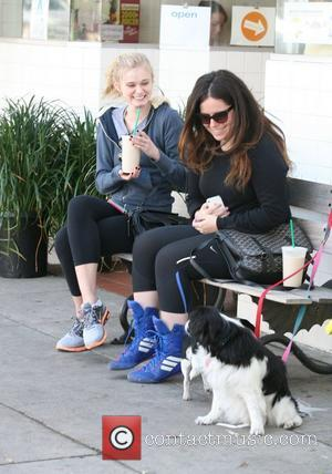 Sara Paxton drinks a smoothie with a friend on a bench outside a juice bar in Hollywood Hollywood, California -...