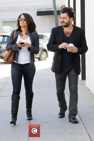 Gugu Mbatha-Raw and a friend leave a salon in Beverly Hills Beverly Hills, California - 26.01.12