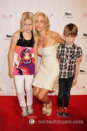 Mason Grammer, Camille Grammer, Jude Grammer The Real Housewives of Beverly Hills at the grand opening of Blizz Frozen Yogurt...