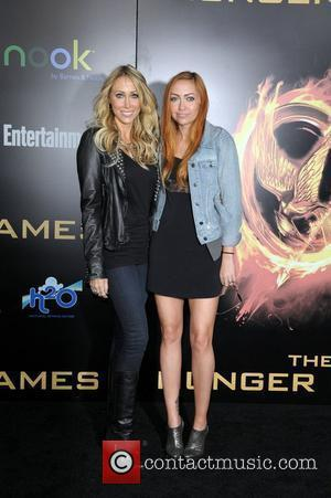 Tish Cyrus and Brandi Cyrus  World Premiere of 'THE HUNGER GAMES' held at Nokia Theatre L.A. Live - Arrivals...