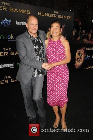 Woody Harrelson; Laura Louie  World Premiere of 'THE HUNGER GAMES' held at Nokia Theatre L.A. Live - Arrivals...