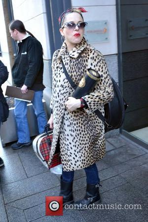 Singer Imelda May is spotted outside the Morrison Hotel sporting a leopard coat and carrying a bottle of Dubliner whiskey...