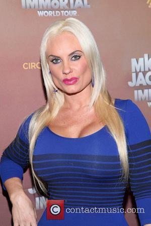 Coco Austin Cirque Du Soleil's Michael Jackson: The Immortal World Tour opening night at Madison Square Garden - Arrivals. New...