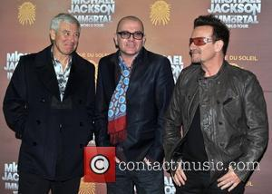 Adam Clayton, Bono and guest Michael Jackson: The Immortal World Tour, stage production of Cirque Du Soleil - European premiere...