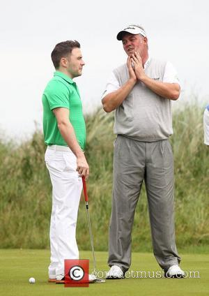 Shane Filan of Westlife and Darren Clarke Pro-am for the 2012 Irish Open held on the Dunluce Links at at...