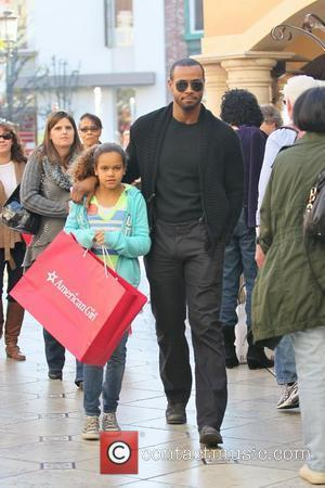 Isaiah Mustafa, the actor who featured in the Old Spice TV advertisements is out christmas shopping at The Grove with...