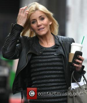 Michelle Collins Michelle Collins carries a takeaway Starbucks drink as she leaves the ITV studios  Featuring: Michelle Collins Where:...