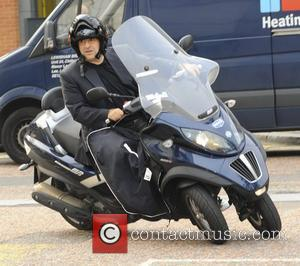 Omid Djalili arrives at the ITV studios on an MP3 Scooter London, England - 24.05.12