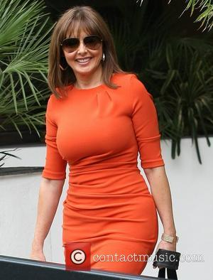 Carol Vorderman outside the ITV studios wearing an orange dress and sunglasses London, England - 30.05.12