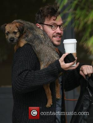 Will Young with a dog at the ITV studios London, England - 27.02.12