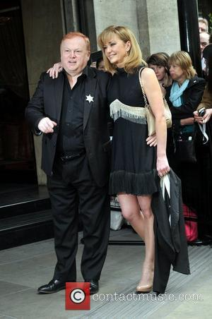 Mike Batt and Guest The 57th Ivor Novello Awards held at the Grosvenor House - Arrivals London, England - 17.05.12