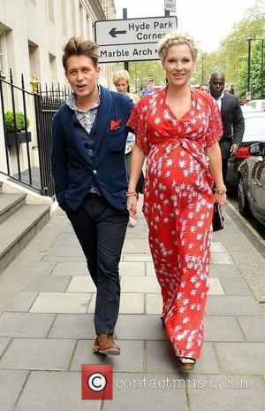Mark Owen and Emma Ferguson  The 57th Ivor Novello Awards held at the Grosvenor House - Arrivals London, England...