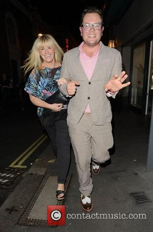 Alan Carr wearing Spatz shoes walks with former Coronation street star, Sally Lindsay past the Ivy  London, England -...