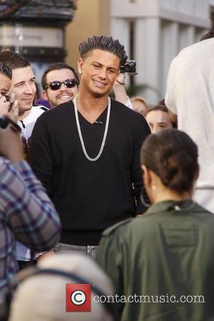 Paul 'Pauly D' DelVecchio of Jersey Shore films an appearance on the entertainment news show 'Extra' at The Grove. Los...