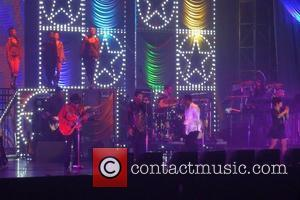 Tito Jackson, Jackie Jackson, Marlon Jackson The Jacksons perform in a special Michael Jackson Tribute Concert Japan - 12.12.11