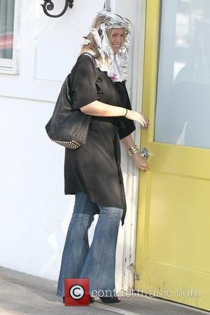 Jaime Pressly entering Byron and Tracey Salon with Aluminum Foil in her hair Los Angeles, California - 23.02.12