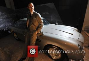 1964 Aston Martin DB5 with a Sean Connery wax figure Designing 007 - Fifty Years of Bond Style - press...