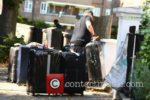 James Corden  arrives home with his family and lots of baggage after spending three months in America  London,...
