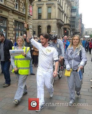 James McAvoy carries the Olympic flame down Buchanan Street in Glasgow Glasgow, Scotland - 08.06.12