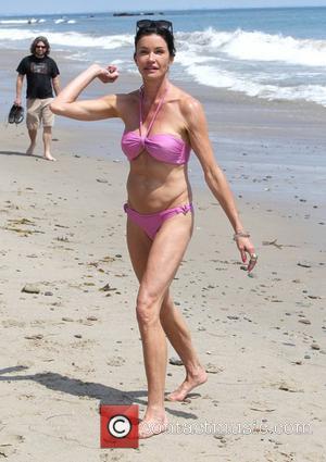 Janice Dickinson spends the day on Malibu beach Los Angeles, California - 03.06.12