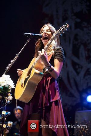 Christina Perri performs during the 'Tour is a Four Letter Word' concert...