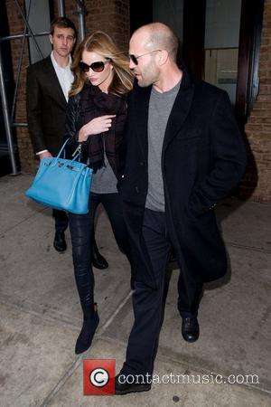 Jason Statham and Rosie Huntington-Whiteley leave a hotel on a cold winter day. Newe York City, USA - 17.12.11