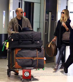Jason Statham and Rosie Huntington-Whiteley arrive at Heathrow Airport.  Featuring: Jason Statham, Rosie Huttington Whitely