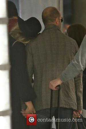 Jason Statham and Rosie Huntington-Whiteley arriving at LAX airport holding hands  Featuring: Jason Statham, Rosie Huntington-Whiteley