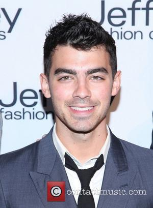 Joe Jonas Jeffrey Fashion Cares 2012 held at the Intrepid Aircraft Carrier  New York City, USA - 26.03.12
