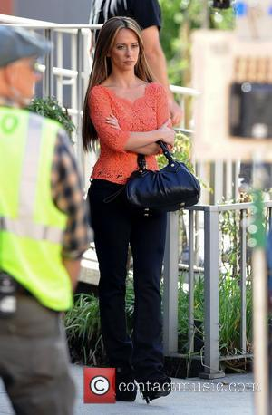 Jennifer Love Hewitt filming a new episode for her TV show 'The Client List' wearing a see-through orange lace top,...