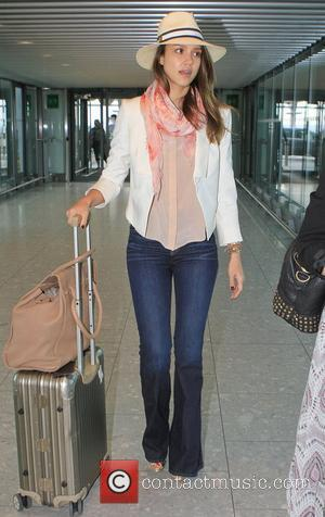 Jessica Alba prepares to depart from Heathrow airport  London, England - 30.05.12
