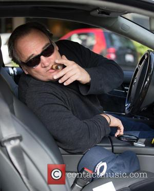 Jim Belushi Jim Belushi smokes a cigar in his car as leaves Barneys New York  Featuring: Jim Belushi Where:...