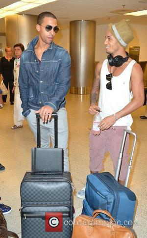 Marvin Humes and Aston Merrygold JLS arrive at Miami International Airport Miami, Florida - 05.05.12