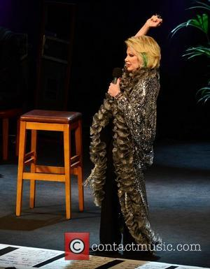 Joan Rivers performs at Vicar Street with notes for her routine taped to the floor of the stage Dublin, Ireland...