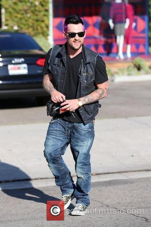 Joel Madden  exits Andy Lecompte salon sporting his freshly dyed purple hair. Los Angeles, California - 08.08.12