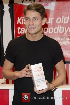 Joey Essex takes part in a Christmas kissing challenge to launch Virgin's new Unlimited PAYG tariff at the Lakeside Shopping...