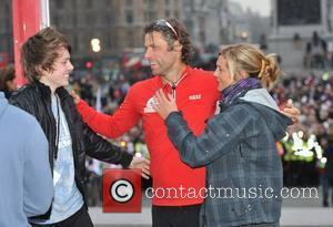 John Bishop  finishes The BT Sport Relief Challenge: Bishop's Week Of Hell on Trafalgar Square. London, England - 02.03.12