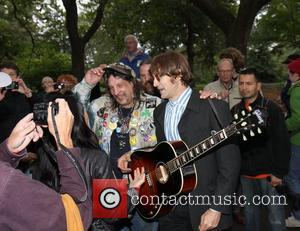 John Lennon impersonator Tim Biancalana Fans gather at the Strawberry Fields memorial for the celebration of what would have been...