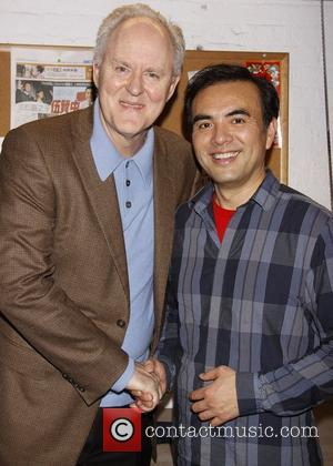 John Lithgow and Larry Lei Zhang as he visits the cast of the Broadway play 'David Henry Hwang's Chinglish' at...